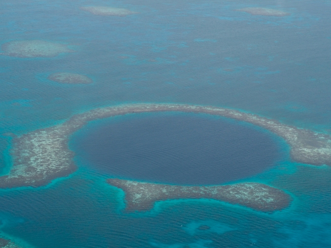 How to book a scenic flight over the Great Blue Hole in Belize