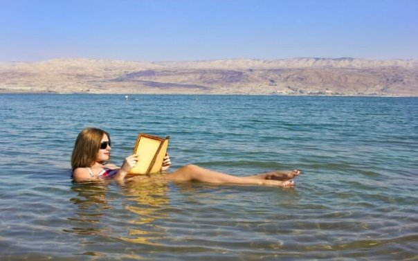 a-woman-reading-a-book-in-dead-sea-in-jordan-ss25072017